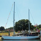 Gipsy Moth IV returns to Buckler's Hard for 50th anniversary celebration