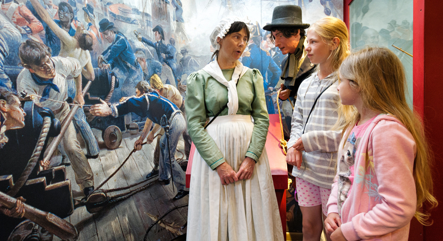 Living History guide with two children in the Maritime Museum
