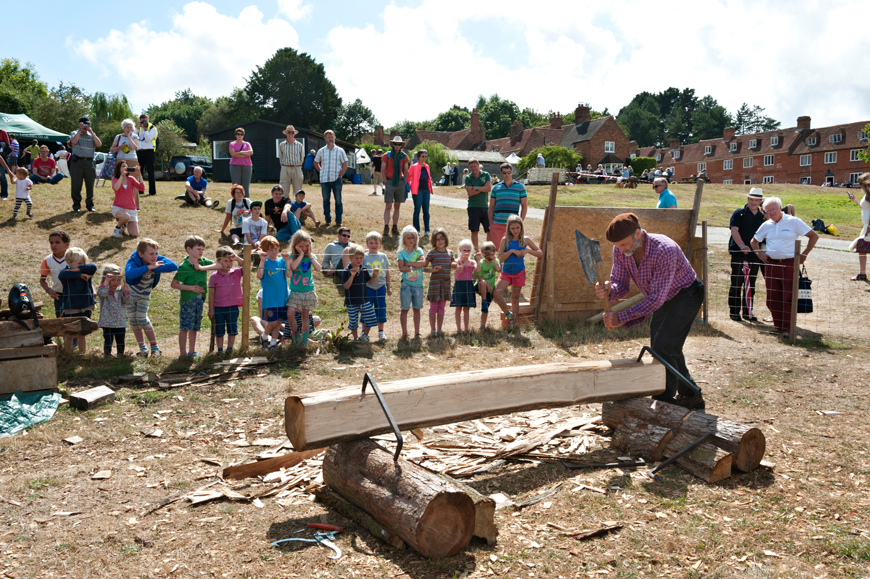 Crowd watching a demonstration at the Shipwright School raising