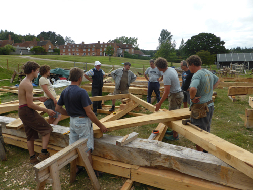 Students working on the Shipwright School timber frame