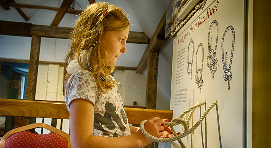 Activities for children at Buckler's Hard - tying a bowline in the Maritime Museum